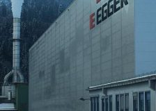 EGGER laminates its first particleboard panel at its new plant in Lexington